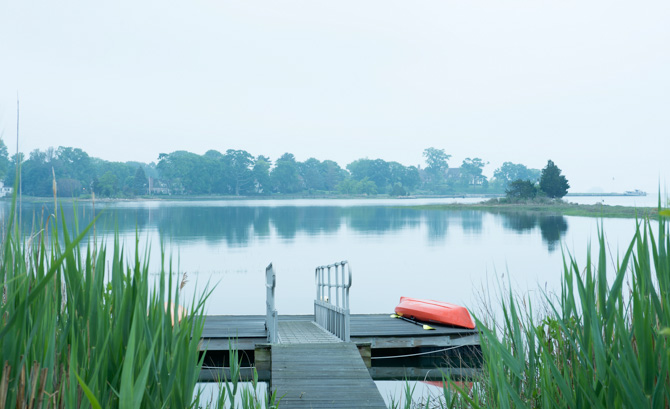 The view off the dock to Long Island Sound, where the homeowners swim and kayak all summer.