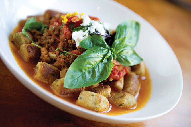 Goat Cheese Gnocci with lamb bolognese, wilted arugula and minted ricotta from Artisan Vermont