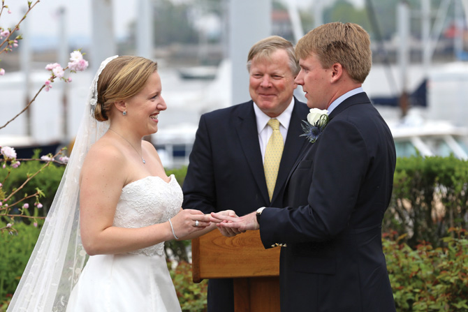The bride and groom with Uncle Hans officiating