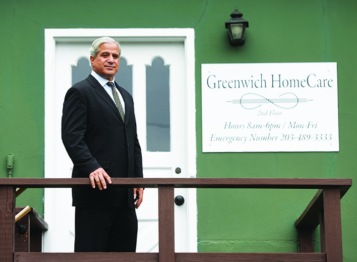 Owner Paul Horowitz poses outside his new business Greenwich Home Care located in downtown Greenwich, Conn. Thursday, Sept. 29, 2016. Horowitz began his company using techniques he found useful when taking care of his wife with cancer.