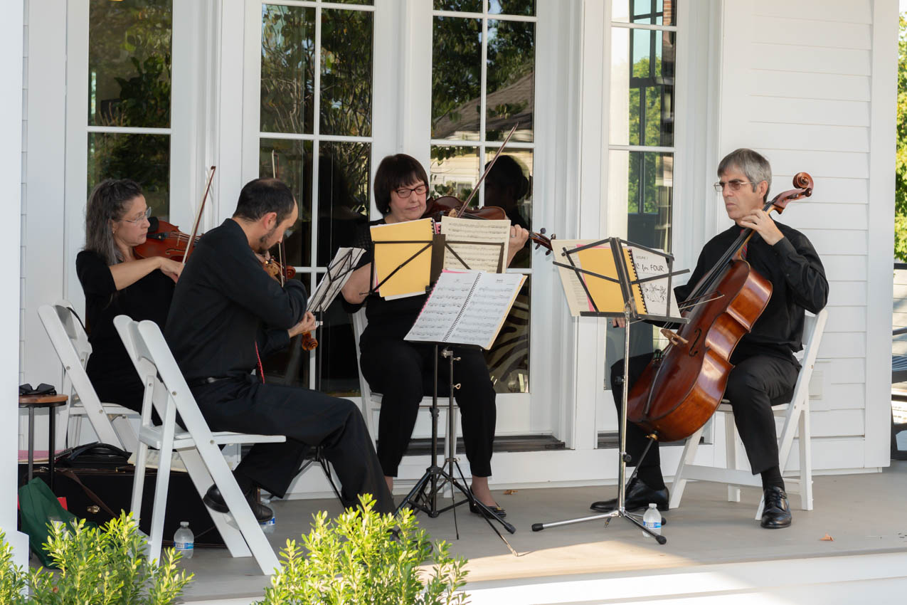 Norwalk Symphony playing on the front porch of 4 Main Street in New Canaan
