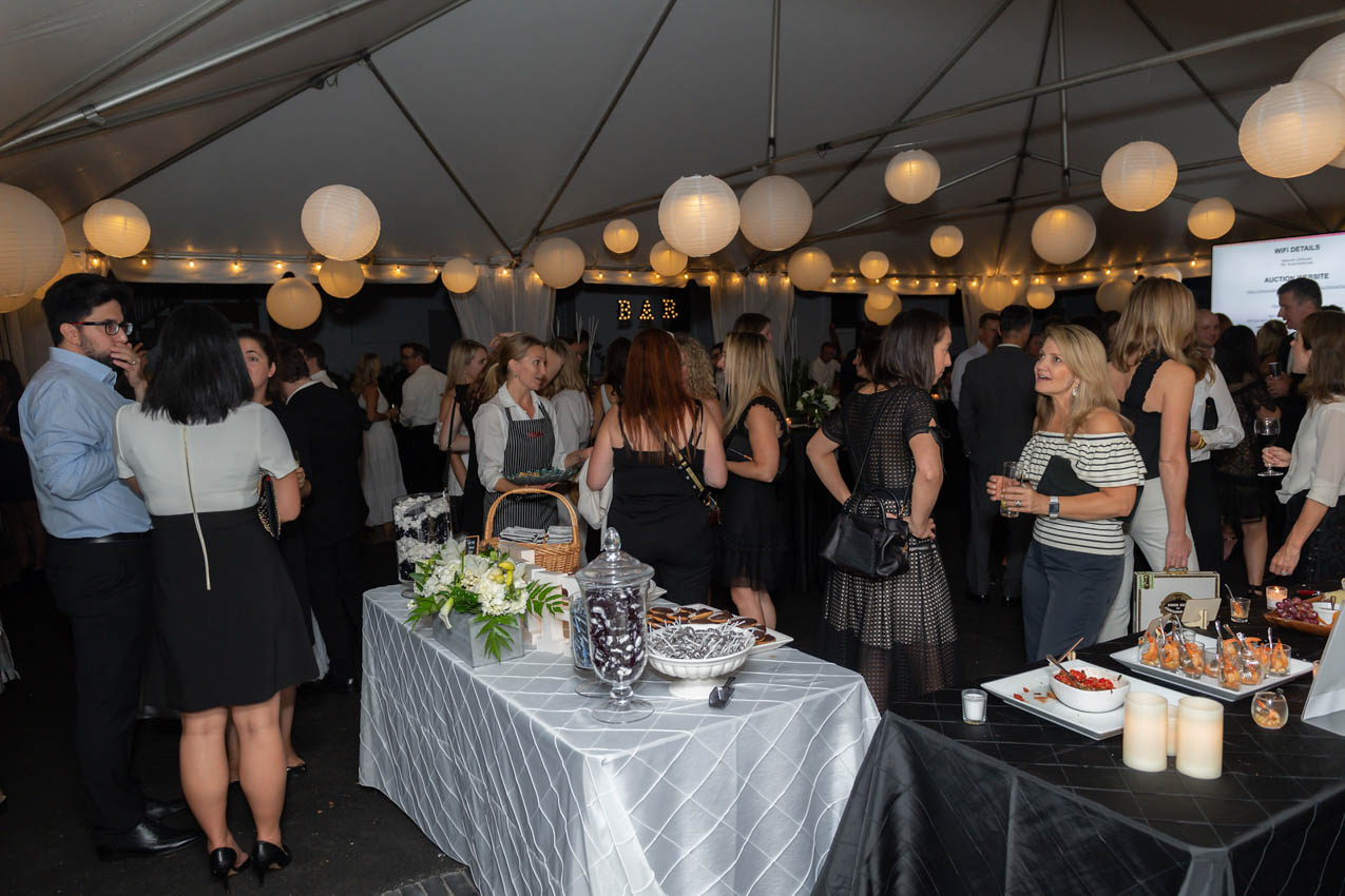 The party had a black and white theme to echo the classic simplicty of the home. The party was filled with candelight, glowing lanterns, and delicious food and cocktails that were evident in the black and white candy bar and signature drinks the